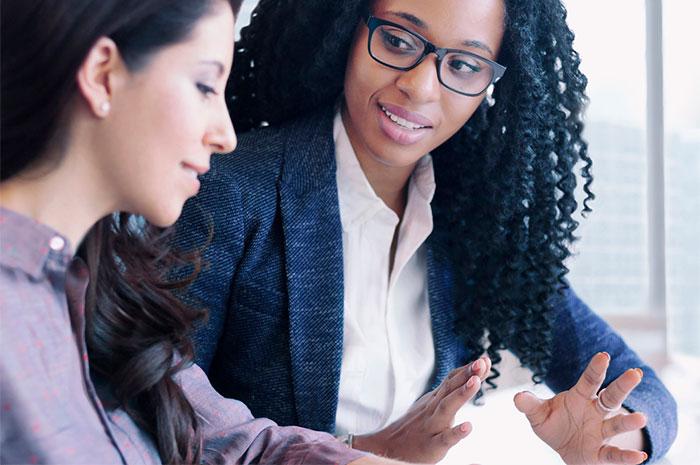 businesswomen conversation
