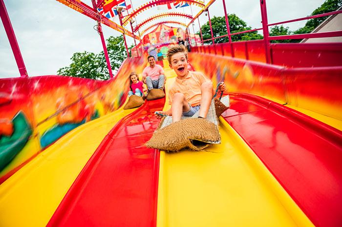 kid on fair slide