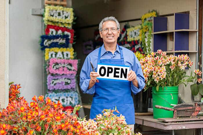 mature flower shop owner