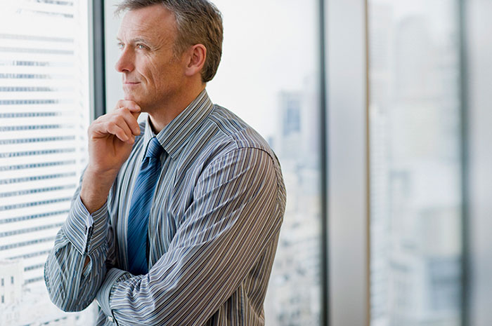 pondering businessman