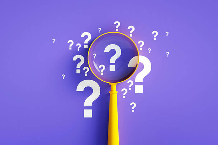 question marks magnifing glass