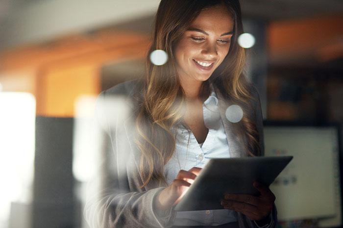 woman using laptop at night